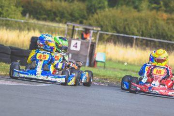 4 karters on a track